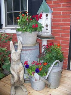 """Carol says, """"Well, of course I love this display - watering cans, flowers and a bunny rabbit! Summer Porch, Decks And Porches, Front Porches, Front Door Decor, Porch Decorating, Watering Cans, Exterior, Bunny Rabbit, Outdoor Decor"""