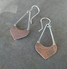 I made this pair of earrings using sterling silver and copper. They measure 2 5/16 inches in length from the top of the ear wire to the bottom of the dangle. They have been oxidized to show detail and add rustic charm.