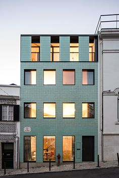 The green-tiled facade of this Lisbon townhouse by Camarim Arquitectos has varying textures and opacities designed to reference the building that previously stood on the site. Facade Architecture, Residential Architecture, Contemporary Architecture, Japanese Architecture, Sustainable Architecture, Building Facade, Green Building, Building Design, Facade Design