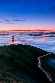 Golden Gate Bridge, San Francisco, CA -   Mesmerizing to watch the fog come in over the hills...