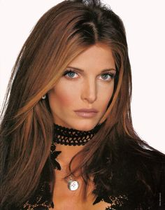 Stephanie Seymour rockin' the face framing highlights, brown lipstick on over-lined lips, contoured cheeks, nude eyes and pencil-thin brows. AND, wearing the quintessential bling: a black choker. Stephanie Seymour, Sienna Guillory, Lauren Ambrose, Elizabeth Moss, Lara Pulver, Amanda Righetti, Jessica Lowndes, Rachel Nichols, Kristin Kreuk