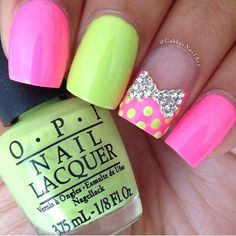 Pink & yellow-green nail art with bow and polka dots.