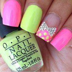 Pink & yellow-green nail art with bow and polka dots.