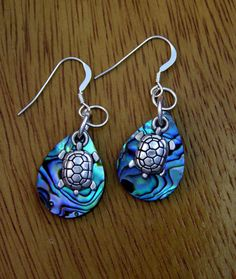 Black Blue Green Paua Abalone Sea Turtle Earrings by Texaswoman. Lightweight earrings, little swimming sea turtle on paua abalone shell which has black, blue and green hues. The shells are very irides Seashell Jewelry, Beach Jewelry, Sea Turtle Jewelry, Turtle Earrings, Turtle Love, Handmade Jewelry, Unique Jewelry, Sterling Silver Earrings, Silver Bracelets
