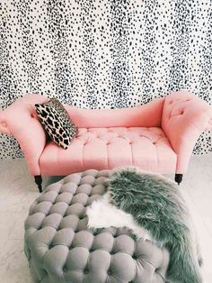 pink small couch leopard pillow grey ottoman and fur