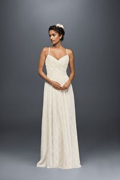 Airy lace looks effortlessly beautiful on Galina's sweetheart wedding dress with spaghetti straps and a pleated bodice. Exclusively at David's Bridal.