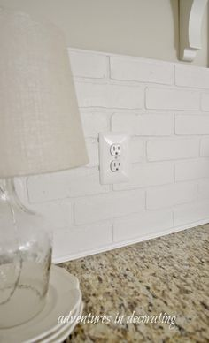 Faux brick walboard from Lowes painted and glued on the add trim to finish