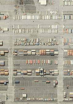 Overhead photography of parking lots? or shipping containors? Love how it makes a beautiful abstract composition.