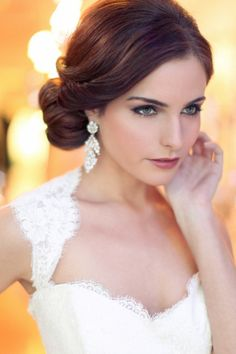 So simple yet elegant! Low side-swept bun with romantic waves to frame the face