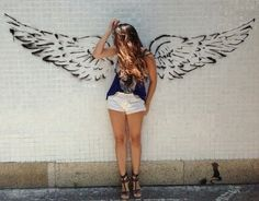 Wings painted on wall photo op