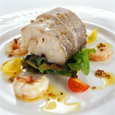 a great Fish Dish, oven baked Hake fillet ...... do you fancy learning this dish? come alomg to one of our cooking Holiday in Malaga, Marbella, Costa del Sol, Spain area.  www.cookingholidayspain.com