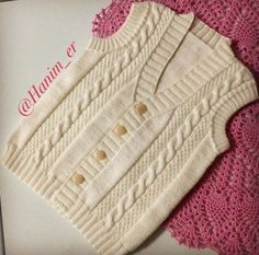 48 ilmek le başla 8 ilmegi bir ters bir düz kalanı 2 ters 2 düz 14 sıra orThis Pin was discovered by Likes 16 CommentsThis model will be a very nice choice for your baby. By examining the picture, you can knit it to your own baby. Baby Sweater Knitting Pattern, Baby Boy Knitting, Knitting For Kids, Baby Knitting Patterns, Knitting Designs, Hand Knitting, Knitted Baby, Baby Boy Vest, Baby Cardigan