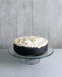 Chocolate Guinness Cake - A Nigella recipe. I made this for my boyfriend's 30th and it went over very well! Note- Remember, the ale will expand when cooking so make sure you use the right size pan!! Also, this cake tastes quite dense and doesn't need icing at all. I made the cream cheese icing but next time I think I'd leave it off. This is a yummy, unique cake!