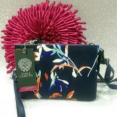 SALE NWT Vince Camuto Crossbody Beautiful leather floral bag and perfect for everyday! Brand new and in perfect condition. Inside it has a cute polka dot print. It could also be use as a wristlet! Vince Camuto Bags Crossbody Bags