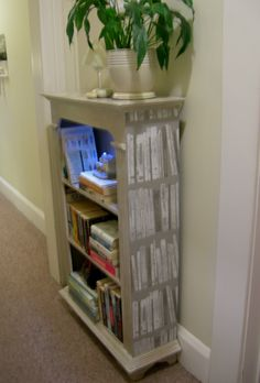 Cheap bookcase painted and wallpapered on the sides