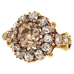 Baroque Revival Diamond #Ring Circa 1870s. Champagne-peach colored main diamond. #Victorian