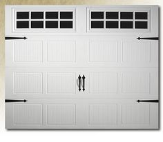This is going to be my next garage door - 'carriage doors' - I think they're beautiful and would add much more character to the front of the house.