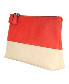 Love the color blocking on this make up back / pouch. It would go great with the sweater from KOHLS.