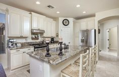 Traditional kitchen with antique white cabinets and breakfast bar island
