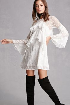 A woven dress featuring a mesh overlay with a floral appliques, a lace yoke and partial sleeves, high neckline, long bell sleeves, two front flounce layers, a back flounce layer, crochet inserts, and an invisible back zipper. This is an independent brand and not a Forever 21 branded item.
