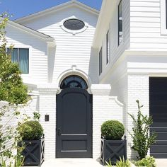 White exterior with black accents. Brooke Wagner Design.