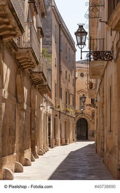 A Street in the Historical Center of Lecce, Italy - A walk through the historical area of Lecce, also known as a Baroque city, will show you an amazing architecure and a true atmosphere of the city. The city itself, with its cobblestoned streets, unique culture and fantastic cuisine is a must-stop if you are visiting Puglia region.