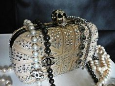 SOURCE: ALEXANDER MCQUEEN & COCO CHANEL / ITEM: MCQUEEN clutch and CHANEL pearls