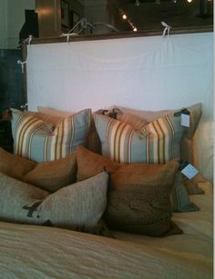 More images of pillows from Juxtaposition.  Love the combination of stripes and organic materials