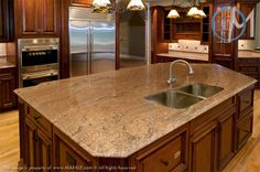 The deep and rich veining of Juparana Golden Vyara is on display on the large island slab.