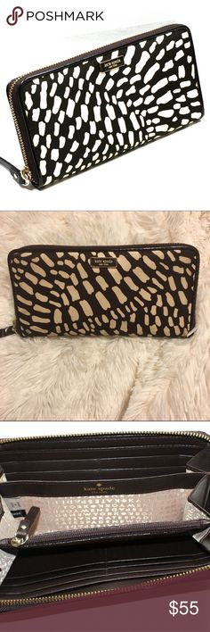 Kate Spade Neda Lindenwood Safari Wallet Dark brown and cream nylon - Dark brown leather Beige signature fabric on the inside - Zip around Closure - Lots of compartments - (L) 8 x (H) 4 x (W) 1 inches. Style number WLRU1239. This wallet is pre loved but in great condition. Minor scratches on front emblem (zoom in) & some wear on the zip around zipper tag (zoom in) *first pic is stock pic kate spade Bags Wallets