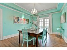 Who says your dining room needs to be fancy & formal? We love the whimsical mint color of the walls & chairs and the pop art decor! Throw in a chandelier for a chabby-chic feel to the room.