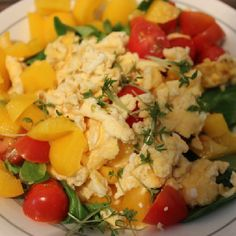 scrambled eggs with tomatoes, pepper, greens and cress
