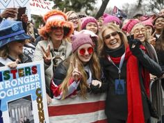 In Grant Park, tens of thousands gathered for a rally that grew so large that organizers had to halt the planned short march through the…