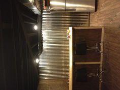 Basement bar and metal wall.