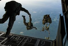 Members of the 22nd Special Tactics Squadron jump from an MC-130H Combat Talon II May 2, 2014, during Emerald Warrior over Hurlburt Field, Fla. Emerald Warrior is an annual, joint exercise to train special operations, conventional and partner nation forces in combat scenarios designed to hone special operations air and ground combat skills, and is the Department of Defense's only irregular warfare exercise. (U.S. Air Force photo/Staff Sgt. Marleah Miller)