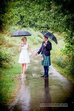 sweet rainy wedding day photo.  Scottish groom + Canadian bride.