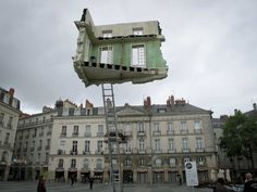 """challenging the gravity"" installation by Leandro Erlich"
