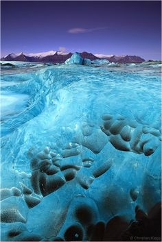 Nature's Artwork - Icebergs on the glacier lagoon Jökulsárlón in Iceland  by Christian Klepp