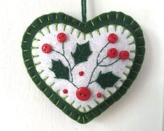 Items similar to Felt Holiday ornament, Felt Christmas ornament, Holly Christmas ornament, Handmade Christmas ornament, Winter felt heart decoration. on Etsy Felt Holiday ornament Felt Christmas ornament Holly Felt Christmas Decorations, Felt Christmas Ornaments, Handmade Ornaments, Handmade Felt, Handmade Christmas, Christmas Diy, Holly Christmas, Fabric Ornaments, Beaded Ornaments