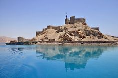 Visit this citadel on Pharaohs Island which is just off the coast of Taba, South Sinai, Egypt. https://ExploreTraveler.com