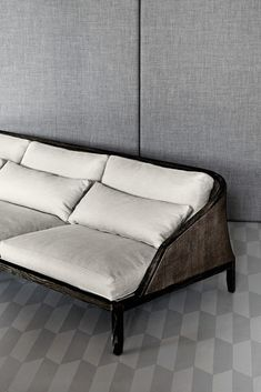A modern take on a bergére sofa. Very low slung and comfy.