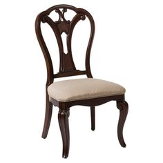 Featuring a regal scrollwork back and upholstered seat, this wood side chair is a stately addition to your dining room or study.    Prod...