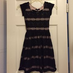 """Lace Dress With Bow NWT XS Emanuelle NWT Black Lace Dress. Size XS. Line with a nude lining fitted on top wit an opening an a accent bow. Bottom is a beautiful very slight fuller skirt. 32"""" Long X 26 1/4"""" Bust X  24"""" Elastic waist . Material does have slight give to it. Please ask all questions prior to buying. Dresses Midi"""