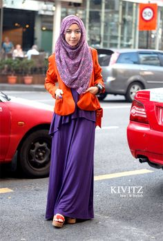 purple + orange = cuteeee.... She's really rocking the bold colors!