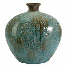 """Display a spray of fresh blooms or arrangement of dried grasses with this rustic ceramic vase, featuring weathered detailing and a crackle finish.  Product: VaseConstruction Material: CeramicColor: BlueFeatures: Scrolling detailsCrackled glaze finishWeathered detailingDimensions: 10.75"""" H x 10.5"""" Diameter"""