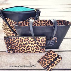 Cool leopard bag collection from wagnerstrasse: handbag with leather handle, tote bag, clutch and matching notebook; all in our favourite (faux)cat style :) At http://www.wagnerstrasse.de #bagcollection2016 #animalprint #animal #leopard #leopardprint #handbag #totebag #notebook #black #pastel #exceptional #roundbag #veganleather #blue