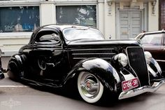 Possibly a 1937 Ford Tudor Sedan V8-60