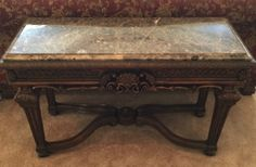 ASHLEY FURNITURE COMPANY CARVED WOOD SOFA TABLE WITH BEVELED MARBLE TOP AND SHELL MOTIF