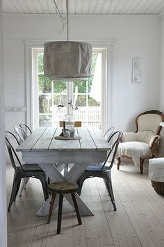 wood rustic country table and light and antique chair in corner