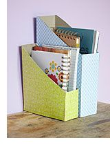 Presenter repin! No need to buy special magazine holders to store your papers and notebooks. Why not repurpose a cereal box? Jazz it up with some cute scrapbook paper.